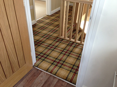 Beige tartan carpet on landing