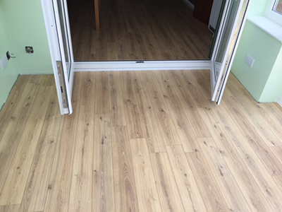 Light coloured laminate floor in conservatory