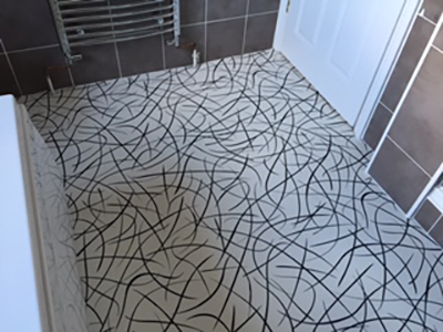 Contemporary swirl patterned vinyl flooring in bathroom