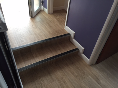 Laminate floor in hallway with steps
