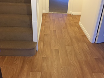 Wood effect vinyl flooring in hallway